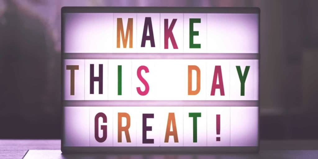 Neon light box featuring the text Make This Day Great in multicoloured letters