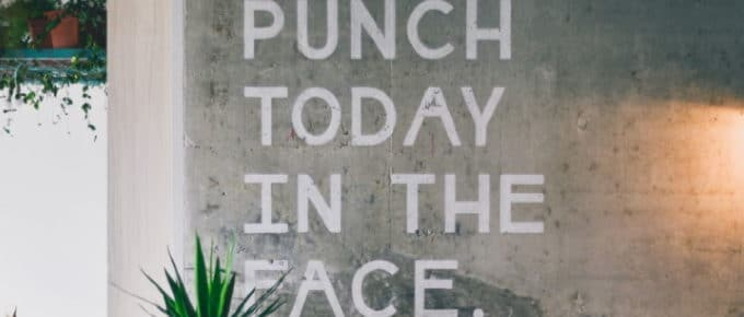 "Motivational wall writing: ""punch today in the face"""
