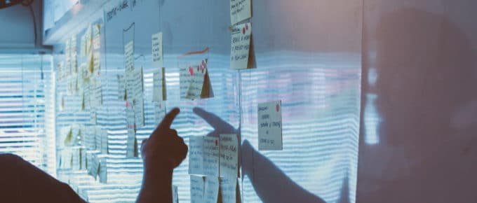 Developing a business strategy at a whiteboard